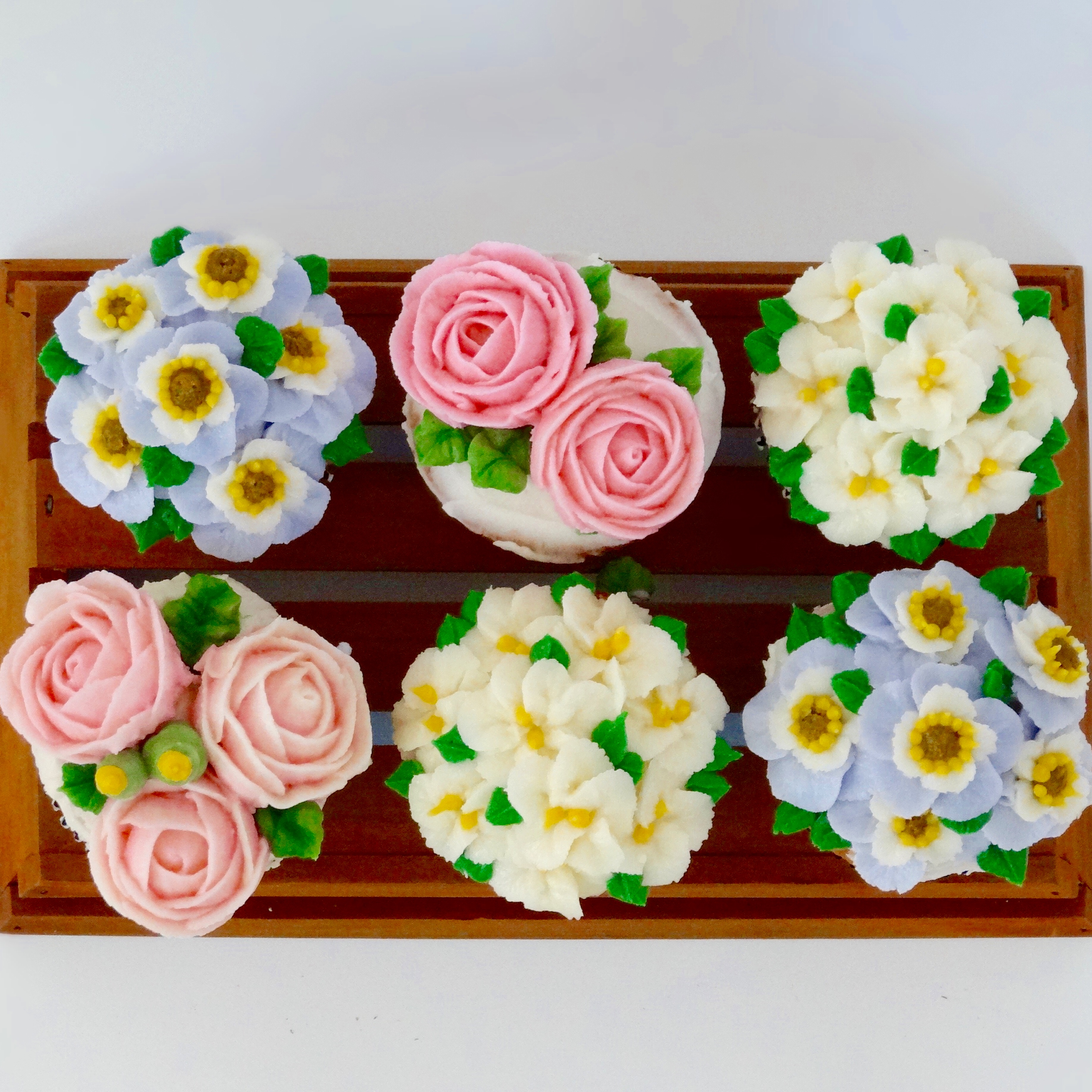 Vanilla cupcakes with buttercream flowers nichalicious baking i saw cake decorating with korean buttercream flowers on pinterest and they looked so beautiful i had to try it i checked out the tutorial on youtube and izmirmasajfo
